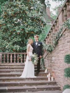 Tyler Garden staircase with bride and groom